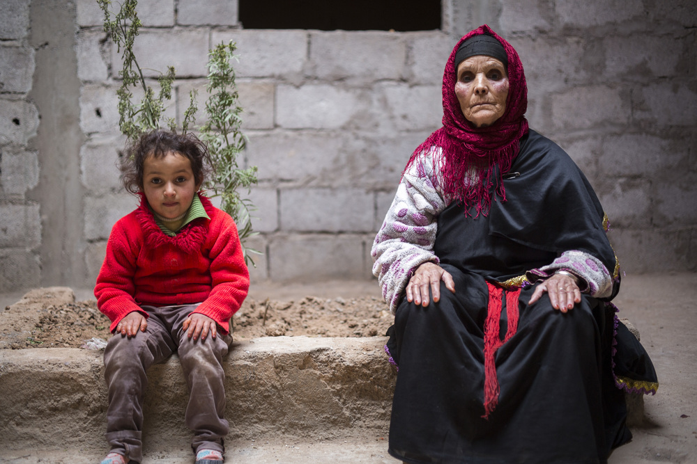 "Fadma Boukhizou, 86, and her granddaughter Zahra Bourraht, 7, span 3 generations of Amazigh women, ""I'm thankful I get to see my children grow up in front of my eyes."""