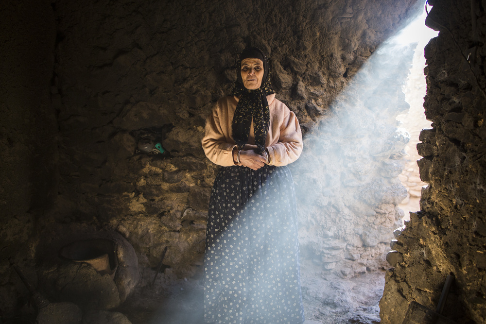 "Ijja Ait Hmad, 62, stands inside the same house she cooks bread. ""Everything we eat comes from our land. We make our own bread, raise our own animals, and plant everything ourselves."""