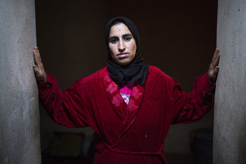 "Fatima Bourraht, 34, poses outside her kitchen, ""The most important thing for us now is to continue the hard work and honesty that has been instilled from oldest generation to this one."""