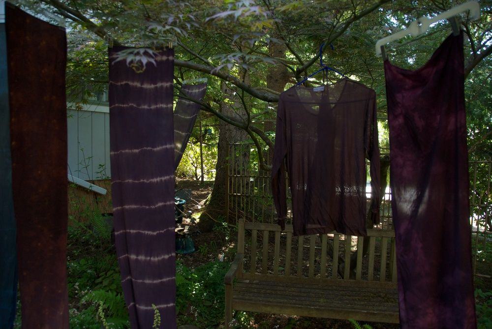 Shibori dyed garments hanging to dry