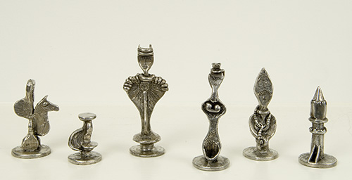 Pewter chess set of six pieces: horse, small abstract pawn, king, queen, bishop, rook
