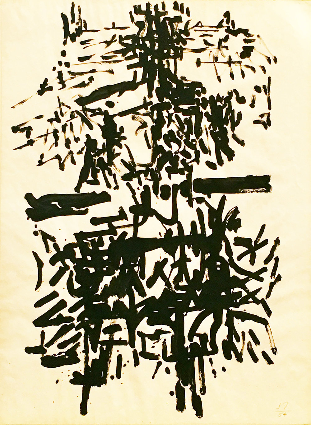 Abstract drawing of black brushstrokes on paper