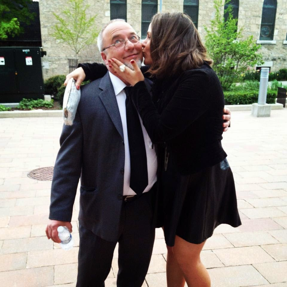 A kiss for columnist, Mike Cahill.