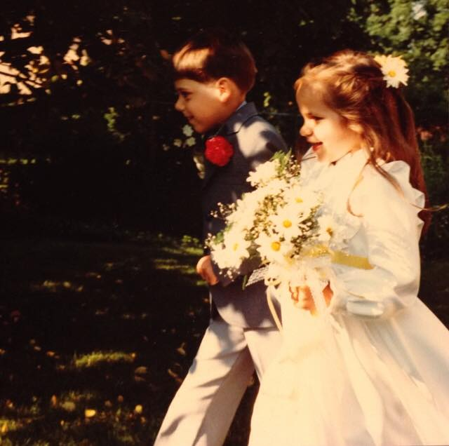 Feeling famous as the flower girl at my mom's wedding.