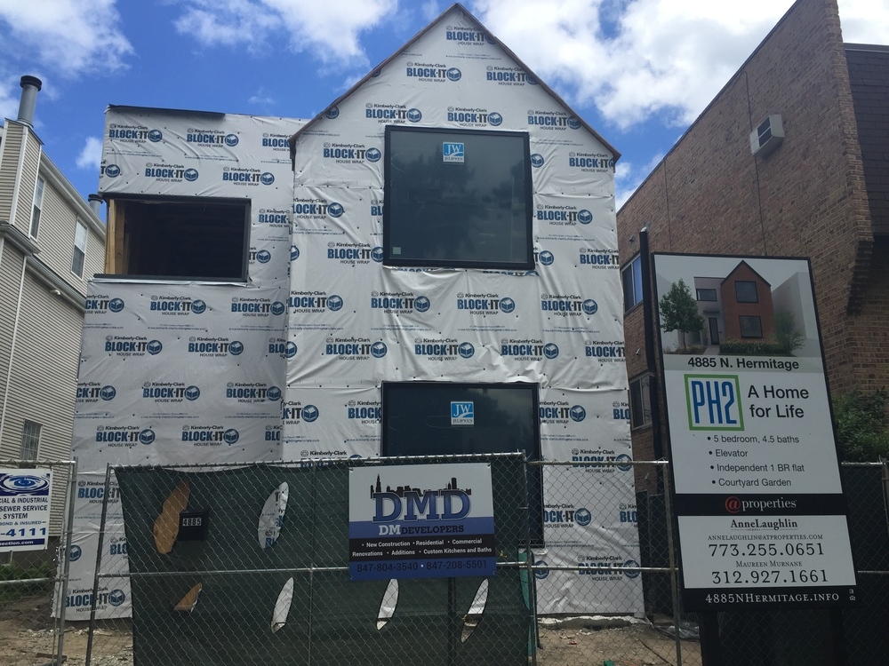 A HOME FOR LIFE  New multi-generational, handicap accessible home takes shape with large windows installed.
