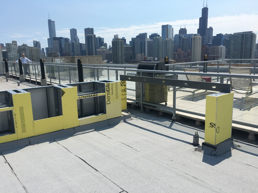 ROOFTOP ADDITION NEARING COMPLETION  Grilling area and bar is taking shape overlooking Chicago.