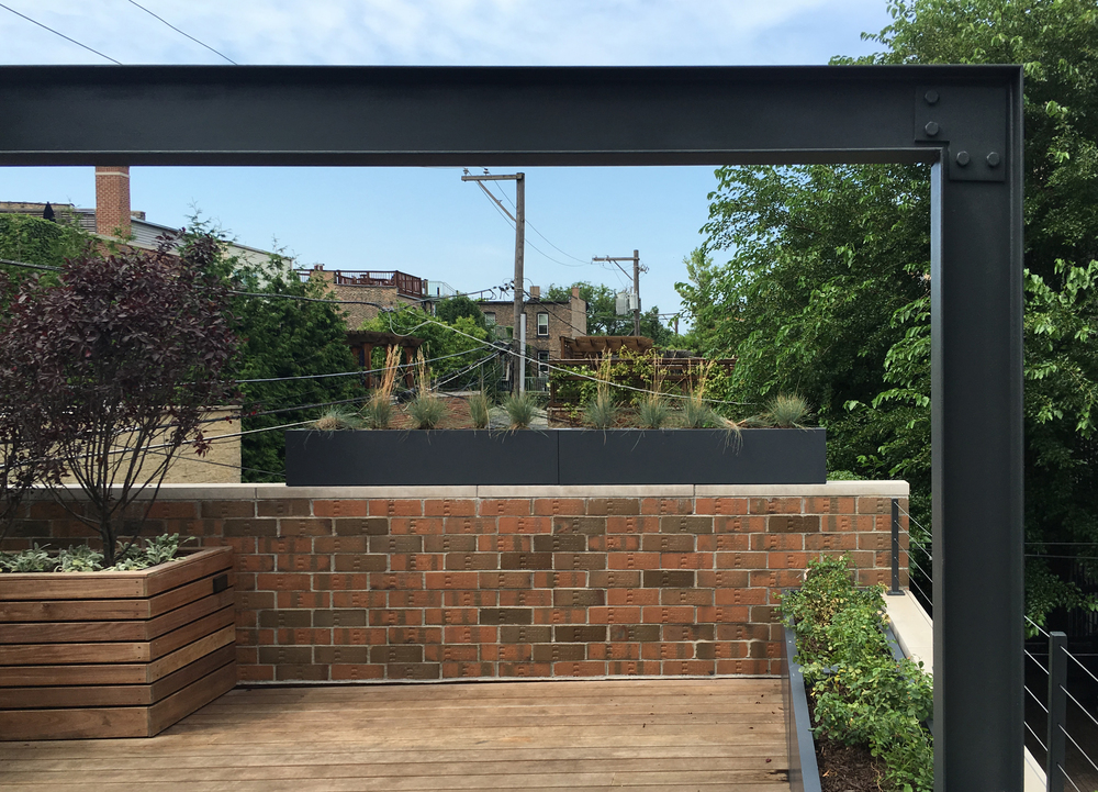 URBAN ROOFTOP OASIS  Rooftop presents a balanced collection of materials with expressed detailing.