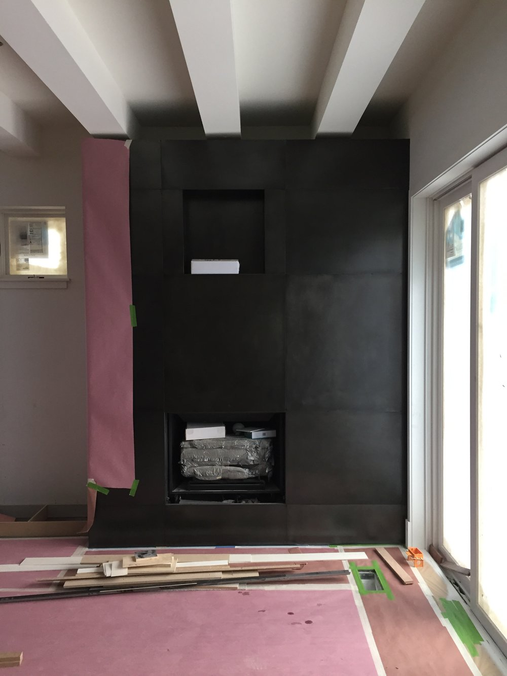 HERMITAGE  FIREPLACE FRAMED  Fireplace finishing touches with blackened steel panels; both enticing and durable.