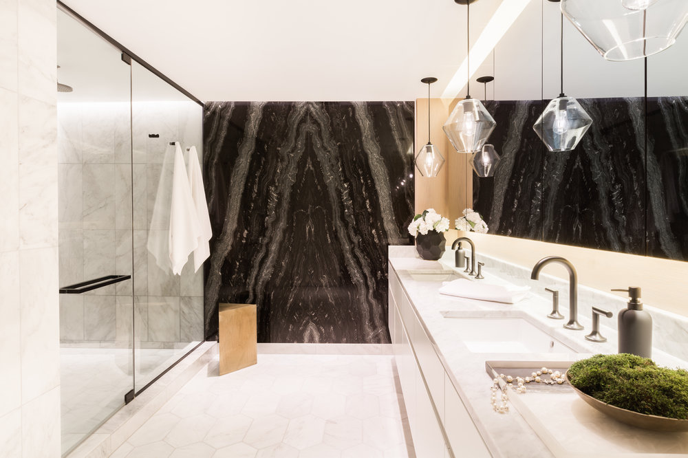 DWELL :CHICAGO  PIED-À-TERRE    Water Tower Flat 's master bathroom renovation highlighted on Dwell.
