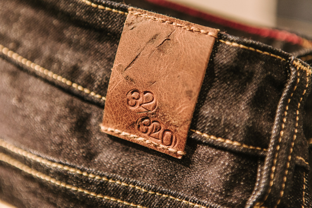 hand-stamped edition number on leather patch