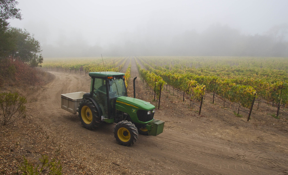 tractor in vineyard at hidden springs ranch