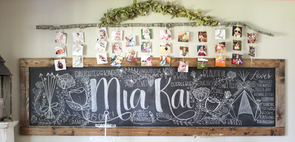 Chalkboard for first birthday party via Jitneys // garden teepee tribal floral party