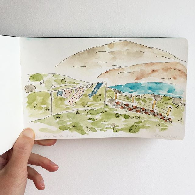 Who knew laundry could be so inspiring? 😍👗💨 Tried my hand at a landscape watercolor painting. 🤔 I can't decide if I like the additional sketching on the first photo or staying simple with the watercolor only. Which one do you like best? . #dailyillustration #watercolor #sakurawatercolors #royalandlangnickel #landscapesofinstagram #mountains #artistsofinstagram #illustration #illustratorsofinstagram #travelingpainter #laundryday #sketchedwatercolor