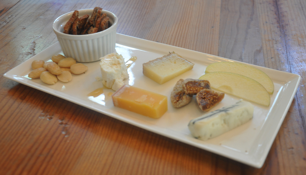 Cheese plate with a variety of cheeses, including local honey and goat cheese from Rancho Dos Amantes