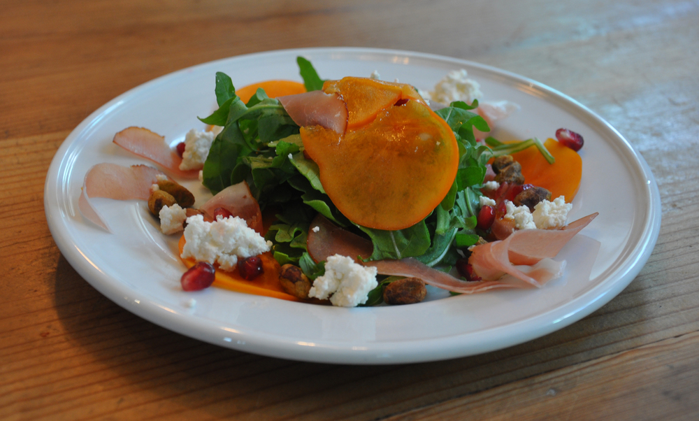 Persimmon, proscuitto & goat cheese salad. The perfect fall colored salad to accompany Thanksgiving dinner.
