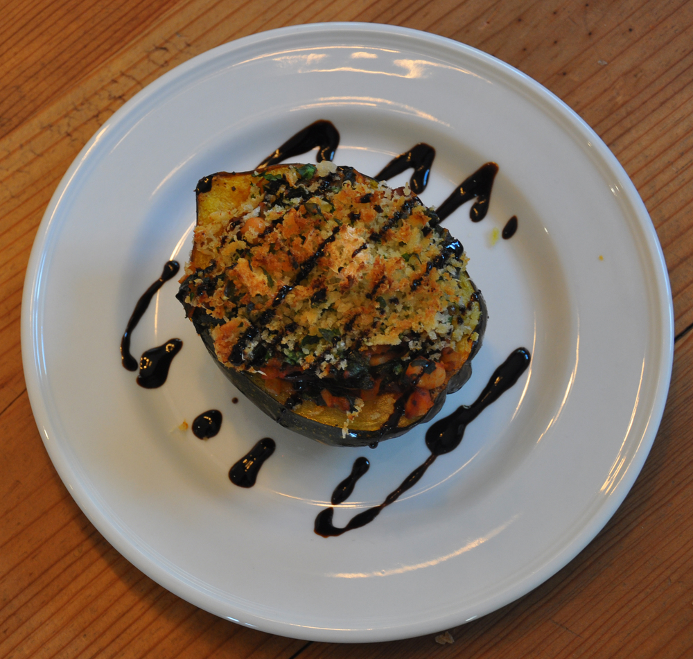 Acorn squash stuffed with kale and white beans topped with a balsamic glaze. A great option for vegetarian guests.