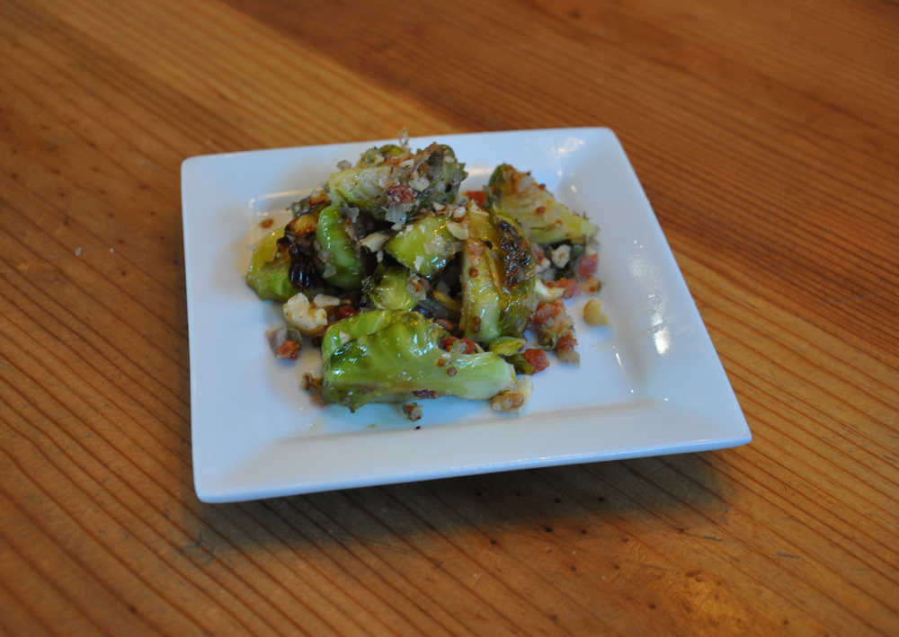 Roasted brussels sprouts and pancetta tossed with a caper-anchovy vinaigrette