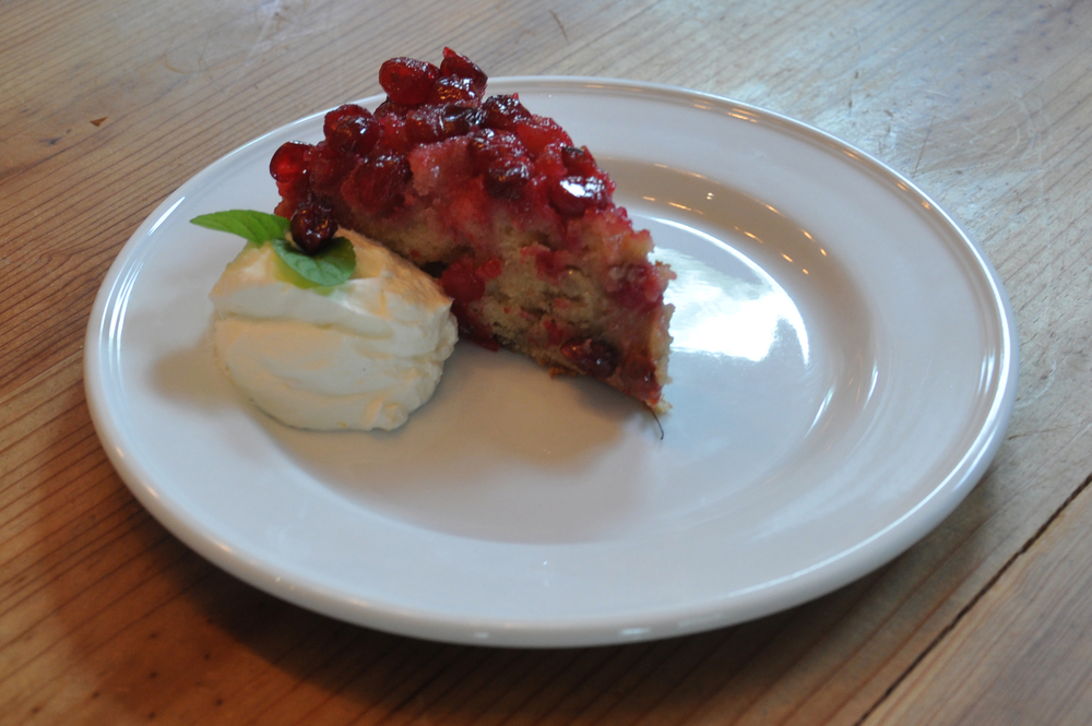 Cranberry upside-down sour cream cake with orange zest whipped cream