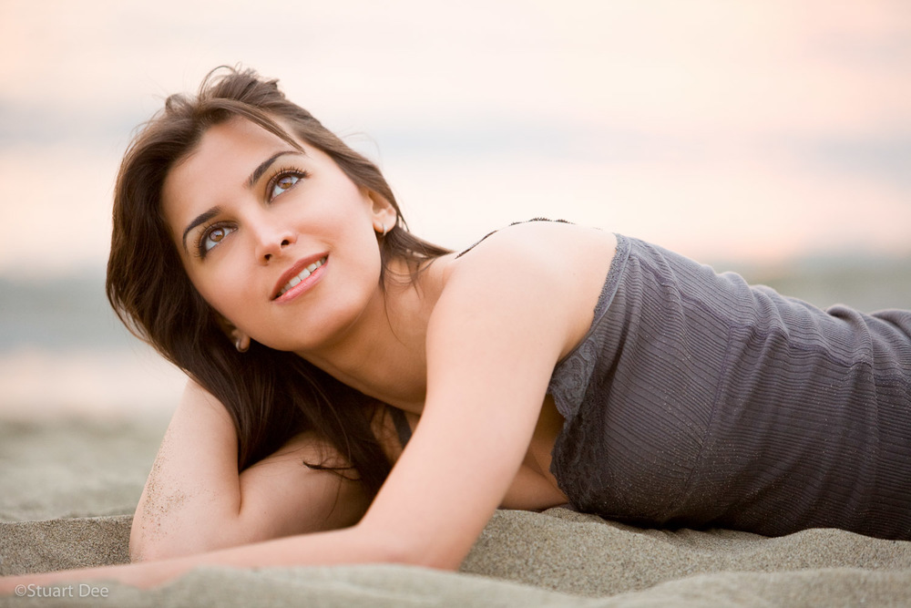 Young woman (Middle Eastern) outdoors, portrrait, resting on a beach, Vancouver, BC, Canada