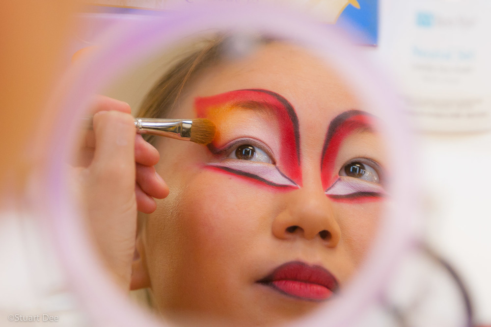 Cirque du Soleil show performer, putting on makeup, Las Vegas, Nevada, USA