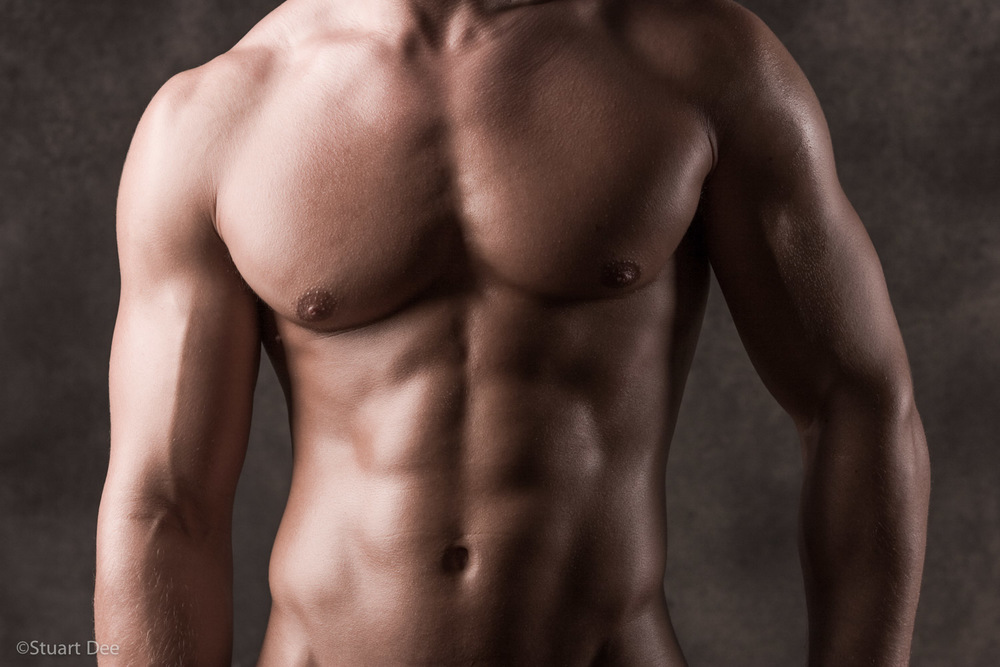 The chest and upper body of a very muscular man.