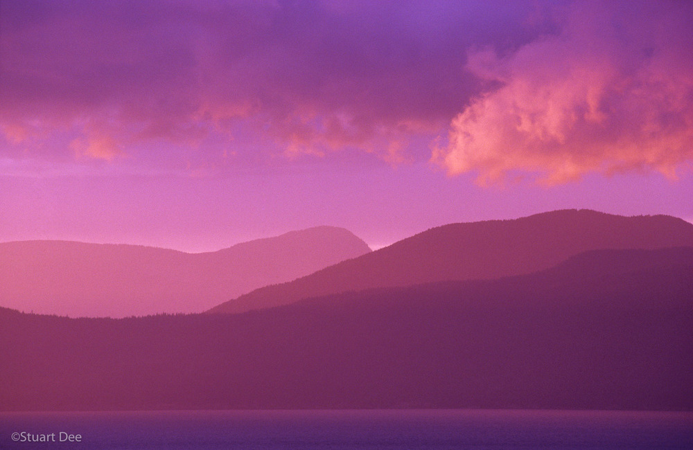 Serene landscape at sunset, showing sea, mountains, and sky, Vancouver, BC, Canada