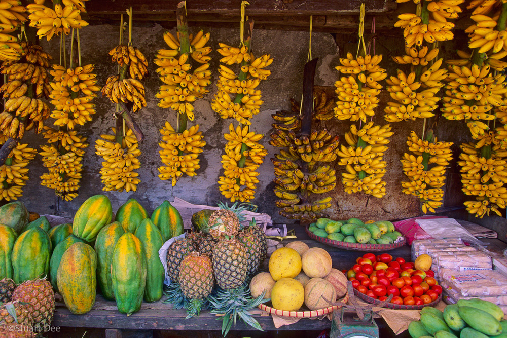 Fruit stand with bananas, papayas, pineapples, mangoes and other tropical fruit. Cavite, Philippines