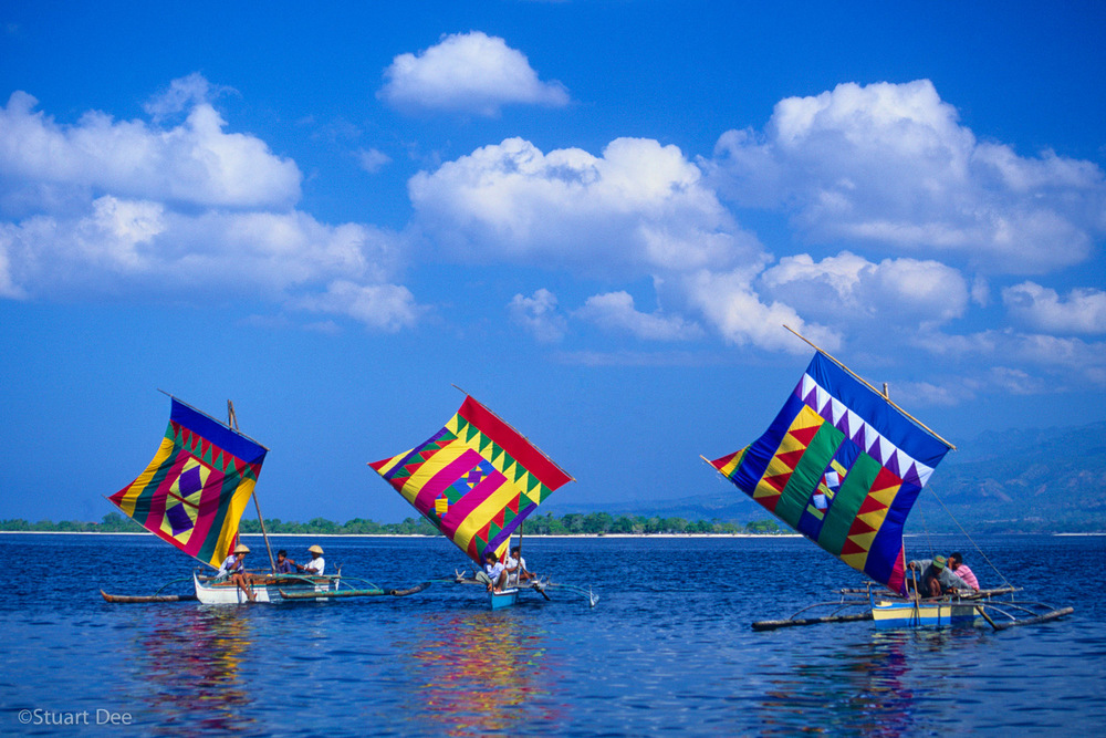 Vintas with colorful sails, Zamboanga, Mindanao, Philippines  The colorful vinta sail is a symbol of the Philippines.