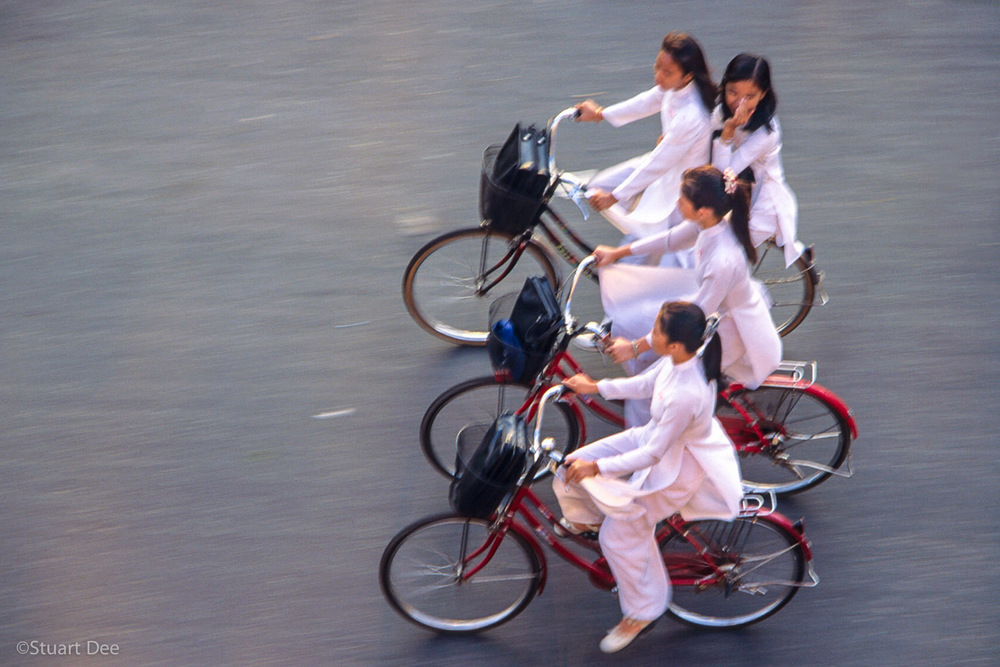 Girls on bikes, Ho Chi Minh City, Vietnam