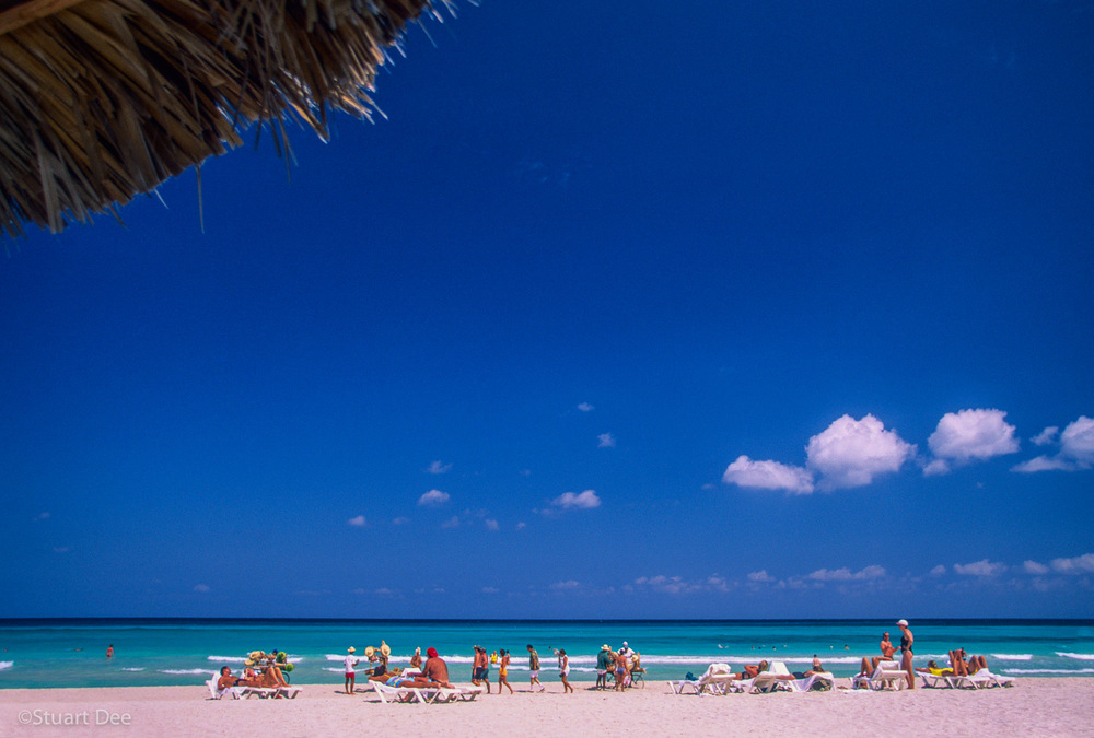 Tourists on beach at resort, Varedero, Cuba
