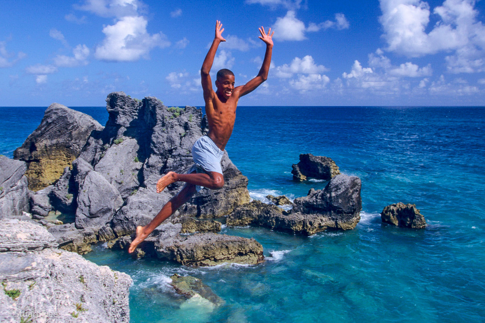 Boy jumping off cliff, Bermuda  R