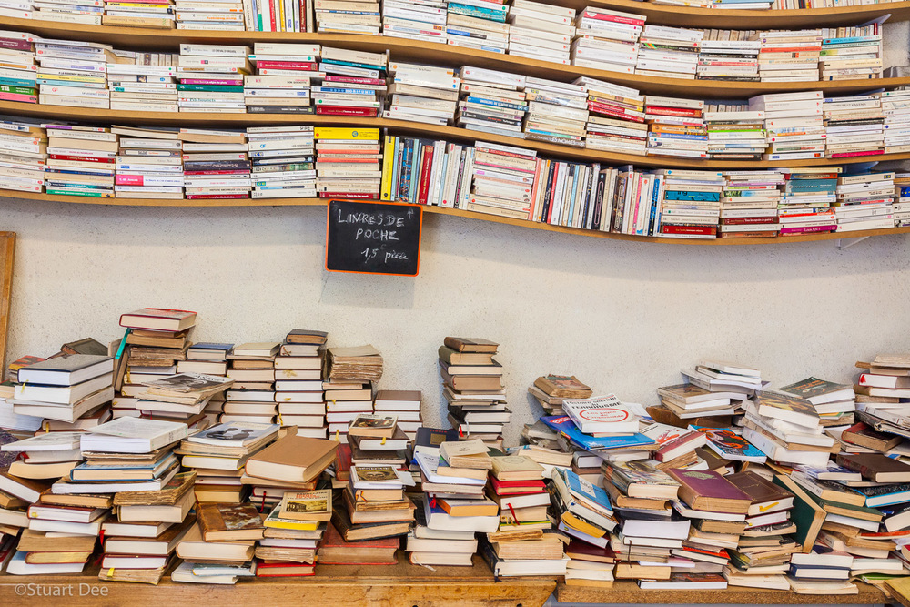 Books for sale, Les Puces de Saint-Ouen Flea Market, Porte de Clignancourt, Paris, France. 
