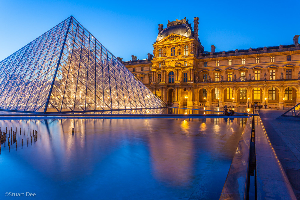 Louvre Museum and Pyramid at twilight/night, Paris, France. The Louvre is one of the most important and is the most visited art museum in the world.