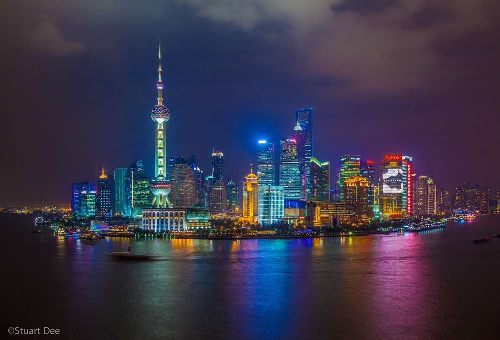 Pudong skyline and Huangpu River at night, Shanghai, China.