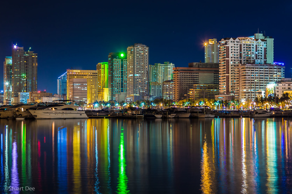 City skyline at night by Manila Bay, Metro Manila, Philippines