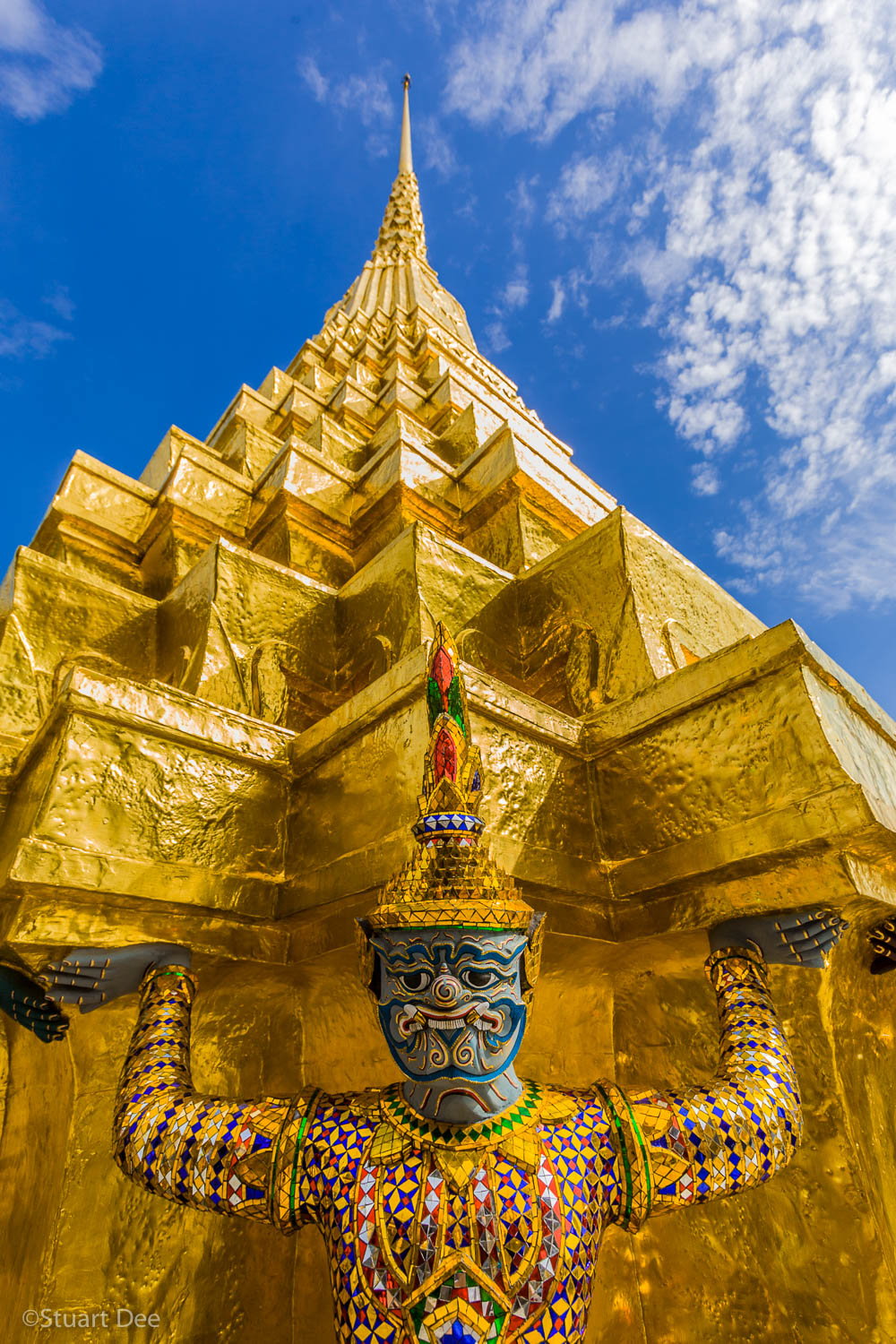 Yaksha(s) supporting a golden chedi. Grand Palace; Temple of the Emerald Buddha (Wat Phra Kaew), Bangkok, Thailand