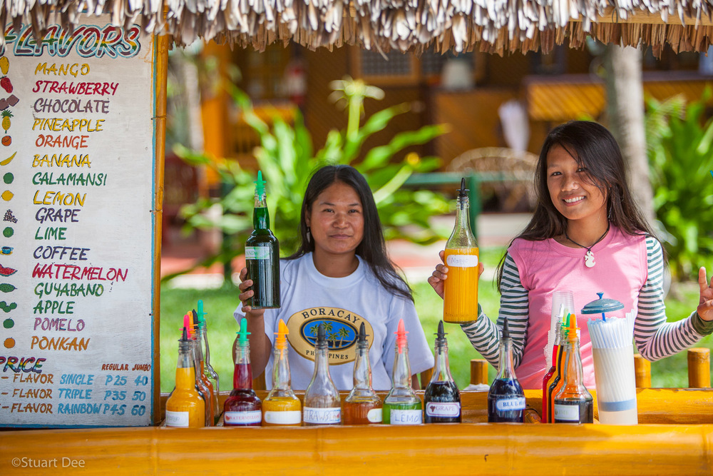 Shave ice vendors, White Beach Path, Boracay, Aklan, Philippines. Ranked as one of the best white sand beaches in the world, Boracay is the most popular beach destination in the Philippines.