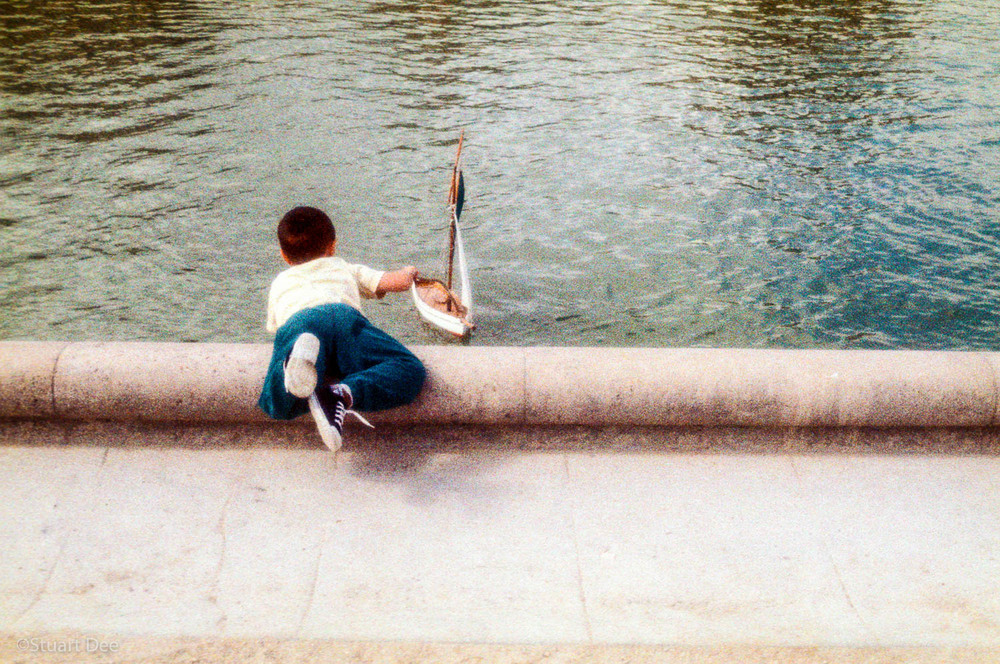 Boy with saliboat, Jardin du Luxembourg, Paris, France