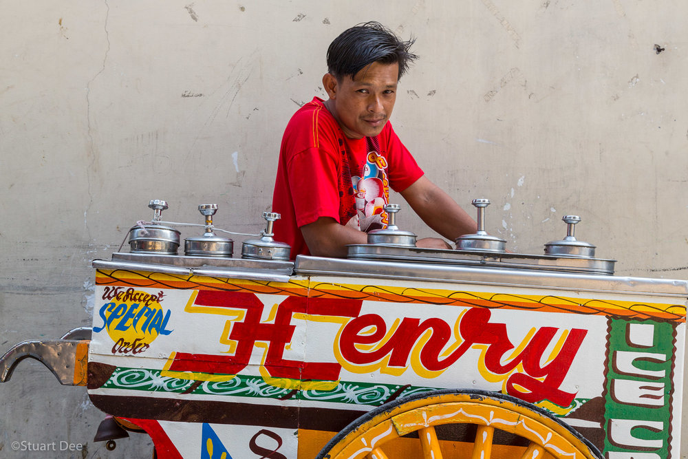 Ice cream vendor, or sorbetero, with traditional hand painted ice cream cart, Manila, Philippines