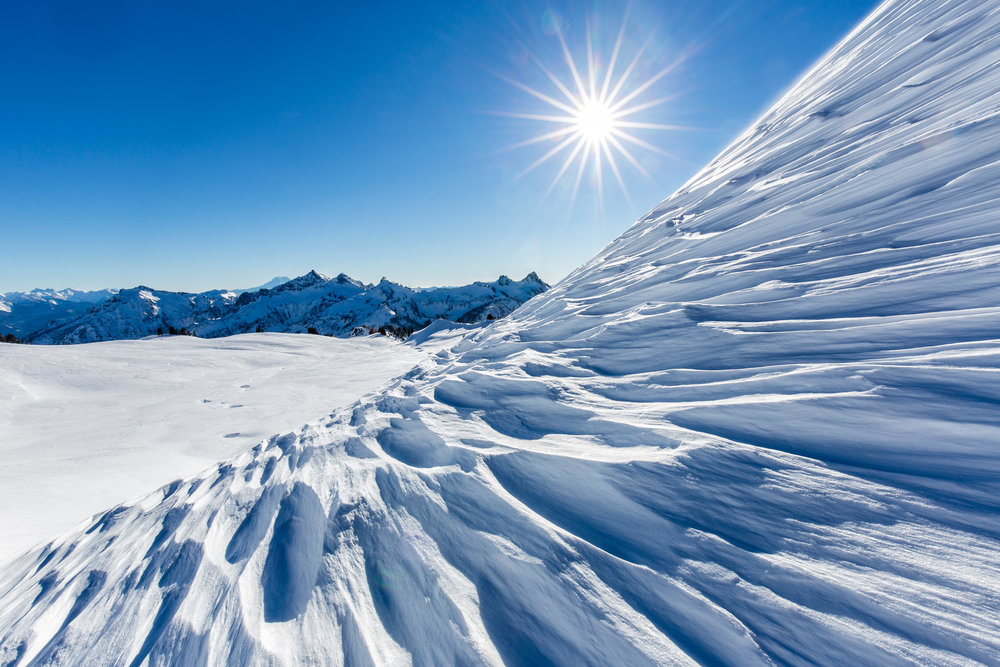 Landscape: Wind sculpted snow on a sunny day in winter at Mt. Rainier National Park, Washington