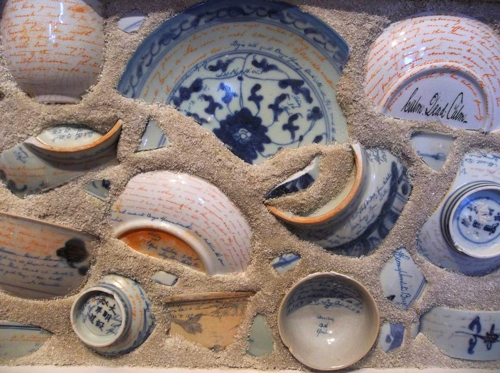 Ceramic shipwreck shards and Chinese export plates, sunk into a mortar and sand mix.  Cape Ann Museum, 2014