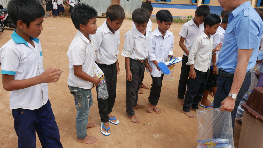 We went to a few rural Cambodian schools and gave out 165 pair of sandals to all the barefoot students we could find.  Interestingly, this was one of our easiest projects to complete, however, the personal reward factor was sky high.  And In addition to the sandals, we gave the schools some general educational and hygiene supplies.  Next time, our goal will be to handout 500 pairs.  The total project cost was $378.