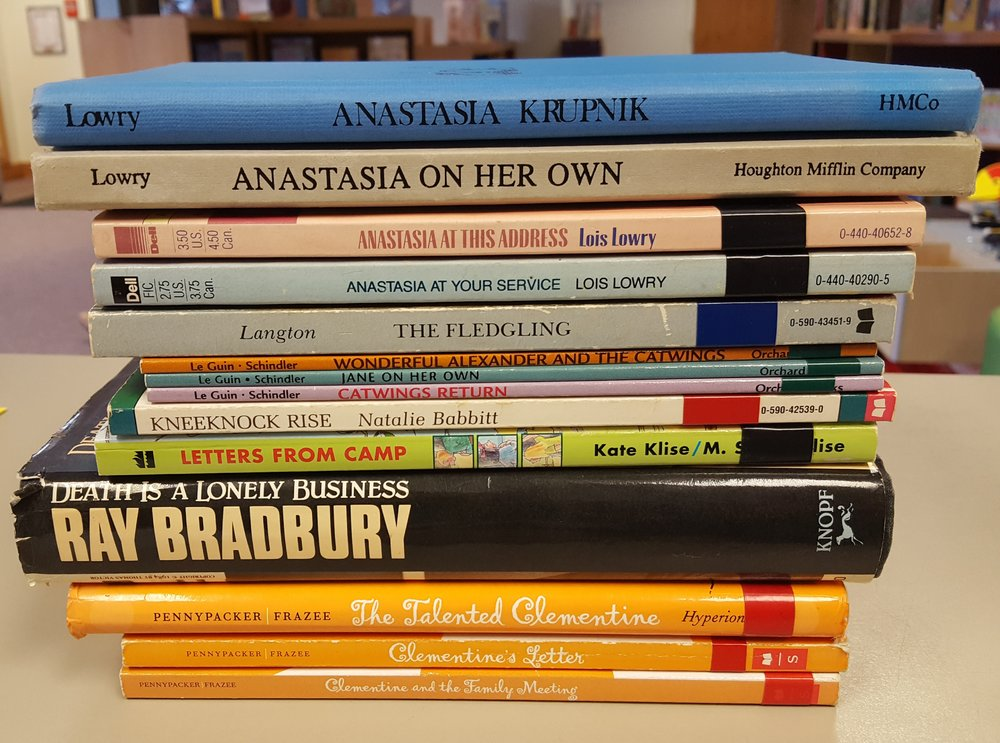 Anastasia Krupnik, Anastasia On Her Own, Anastasia At This Address, Anastasia At Your Service, by Lois Lowry; The Fledgling, by Jane Langton; Catwings Return, Jane On Her Own, Wonderful Alexander and the Catwings, by Ursula K. Le Guin; Kneeknock Rise, by Natalie Babbitt; Letters From Camp, by Kate Klise; Death is a Lonely Business, by Ray Bradbury; The Talented Clementine, Clementine's Letter, Clementine and the Family Meeting, by Sara Pennypacker.
