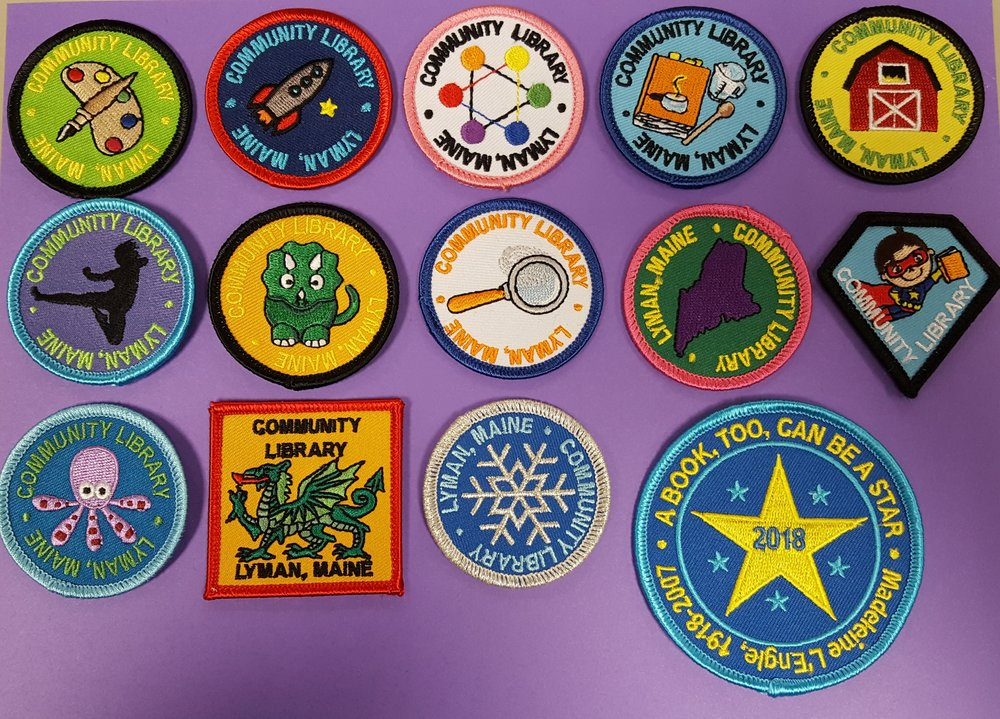 Badges available at our library as of this month  In order from left to right, top to bottom: Art, Space, Color, Cooking, Farms, Movement, Dinosaurs, Mystery, Maine, Heroes, Ocean, Fairy Tales, Winter, and 2018