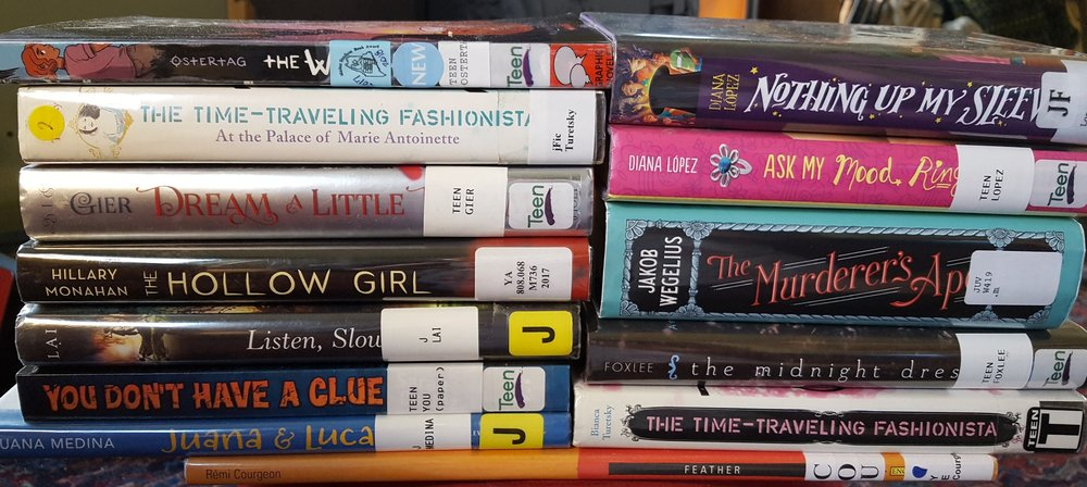 A pile of thirteen books I lugged home from the library; or, WHAT IS MY PROBLEM IDK IDK IDK