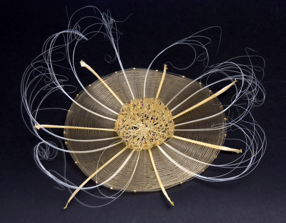 Gerri Johnson-McMillin Champagne Caviar, 2010 Fishbone, champagne monofilament, crocheted mono, gold beads  9 x 9 x 4 inches  /  22.9 x 22.9 x 10.2 cm  /  GJ 3
