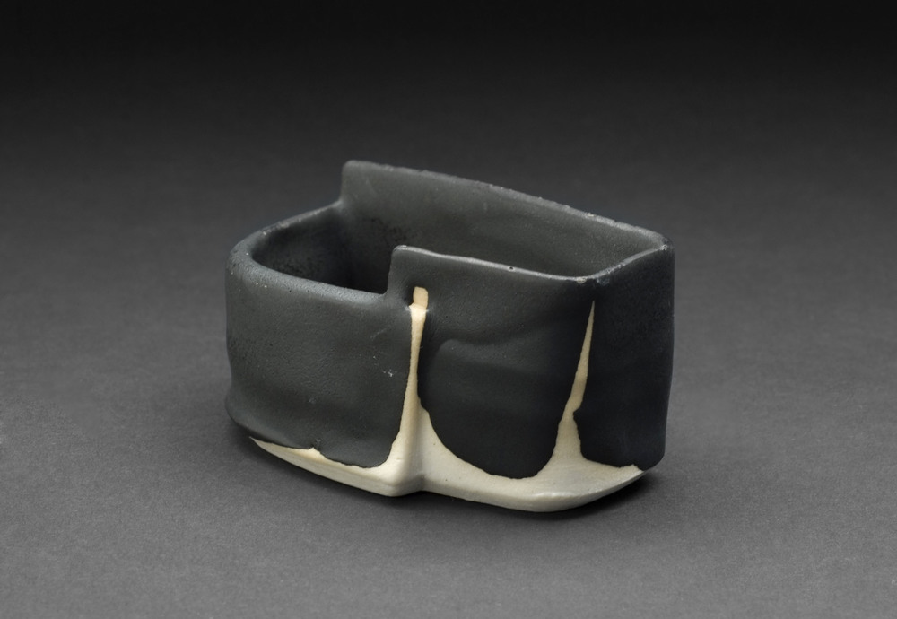 Robert Fornell    Black Angle Guinomi  , 2012 Porcelain 1.5 x 3.75 x 2.25 inches  /  3.8 x 9.5 x 5.7 cm  /  RFo 105