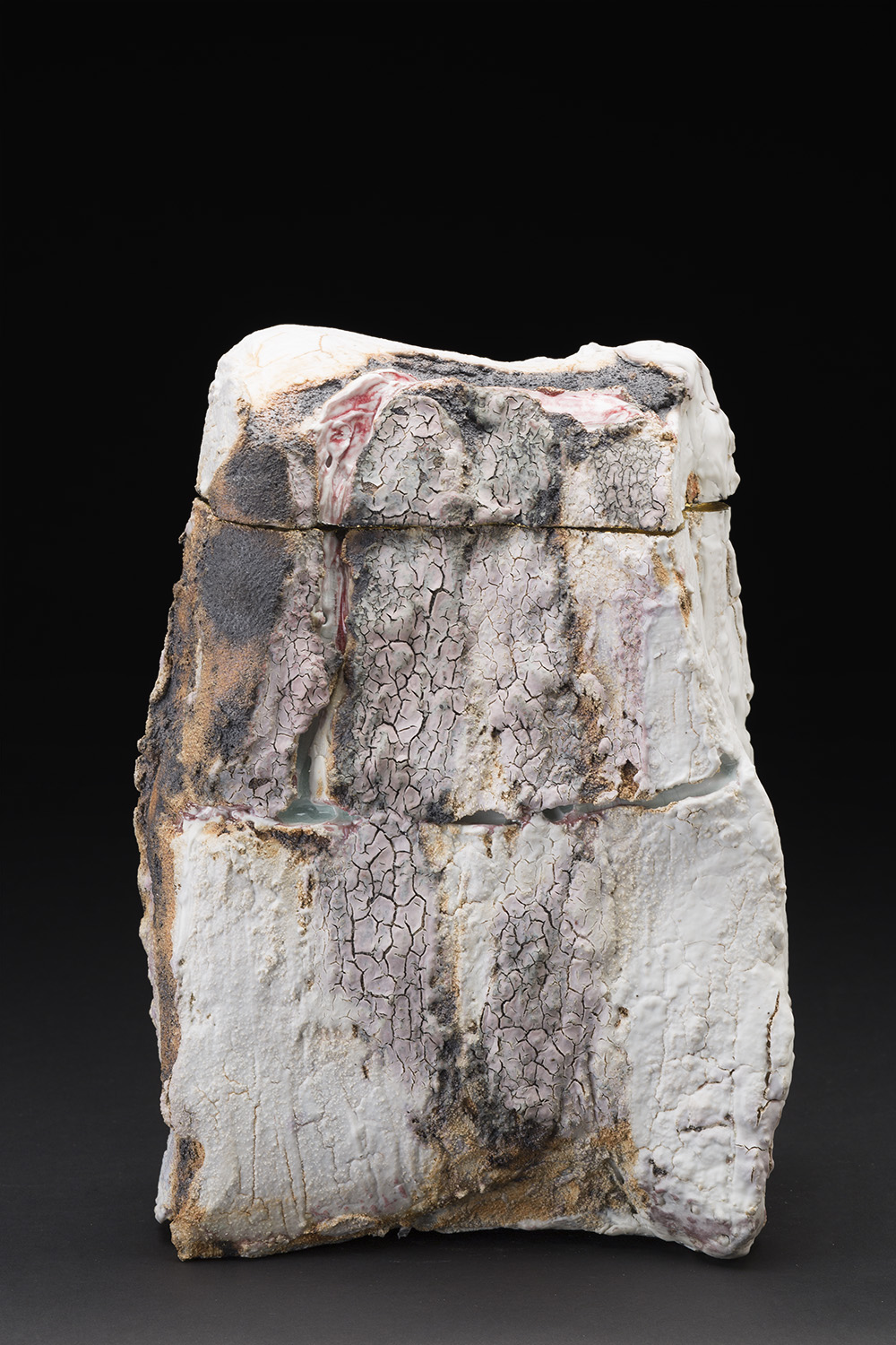 Eddie Curtis    Rock  , 2012 Modified porcelain, applied texture and oxides on outer surface, celadon glaze on inner surface, 22ct gold leaf detailing 11.5 x 8.5 x 5 inches 29.2 x 21.6 x 12.7 cm ECu 8