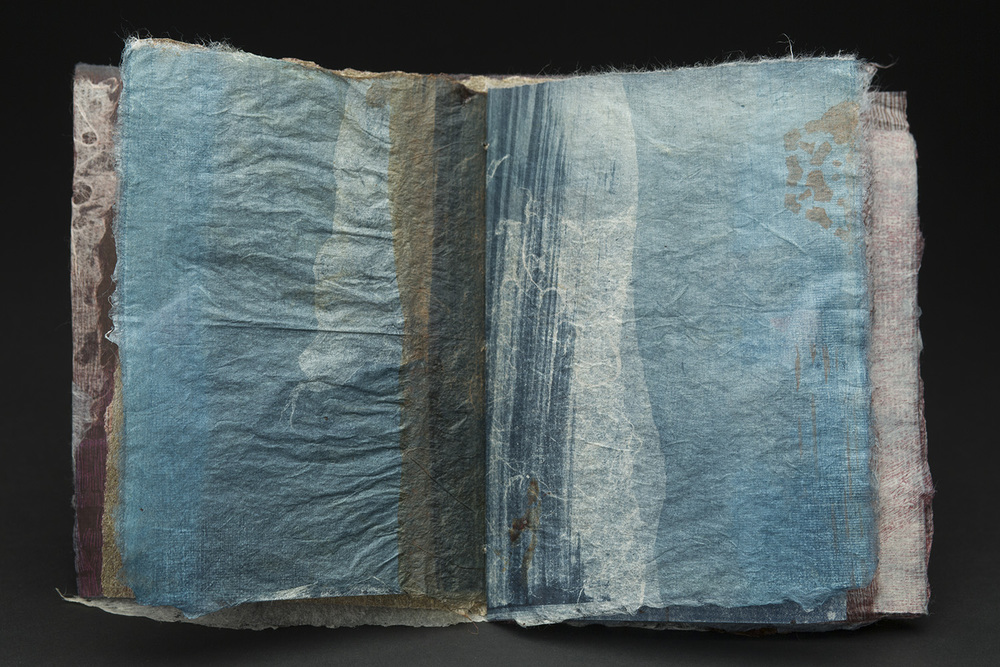 Yuko Kimura    Sample book III  , 2015 Etching, indigo dye, persimmon dye on handmade paper (abaca, cotton, kozo) and old bookpages 6 x 4.75 x .25 inches 15.2 x 12.1 x .6 cm YuK 37
