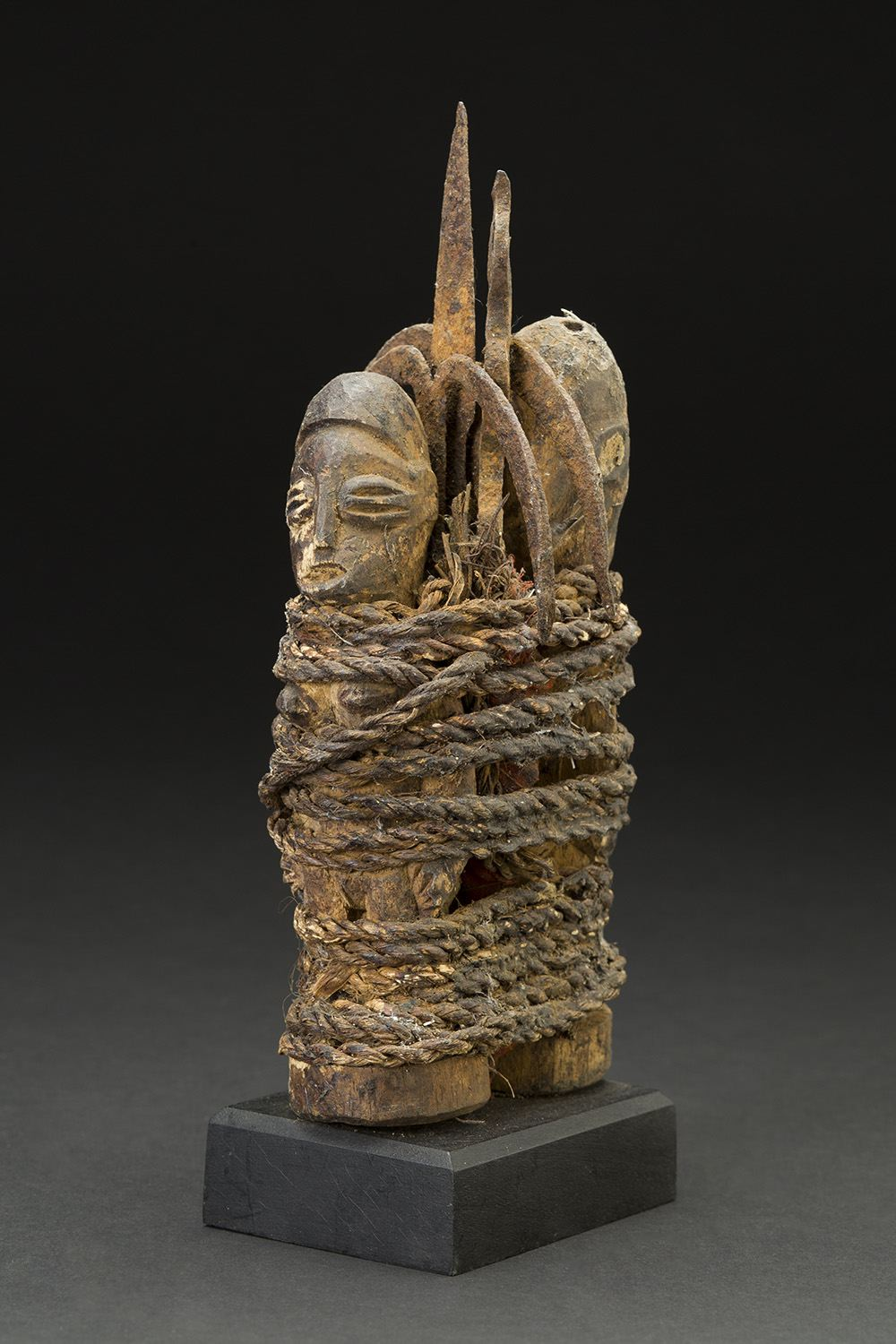 Africa    Vodun Sculpture - Adja People - Benin  , Mid. 20th C. Wood, metal, natural fibers 9 x 3.5 x 3.5 inches 22.9 x 8.9 x 8.9 cm Af 308